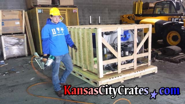 Large slat crate loaded onto industrial pallet
