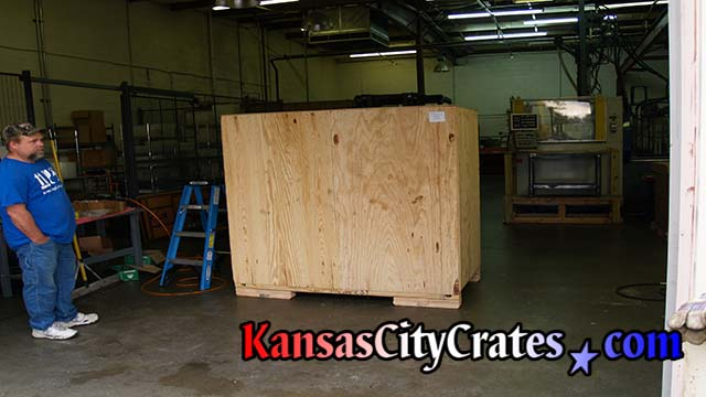 Craters closing industrial crate for shipment to Germany