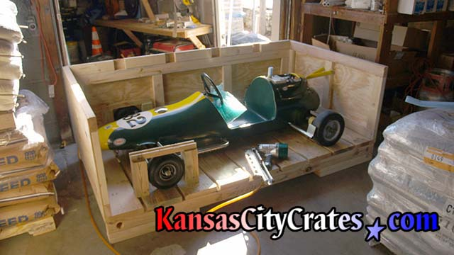 Go-Kart secured inside industrial crate