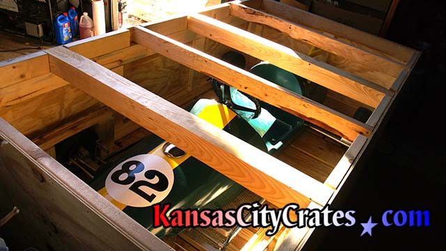 Industrial crate with four by four lid supports enable crates to be stacked during transport