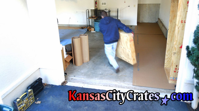 Garage floor protected with cardboard before crates are staged on them.