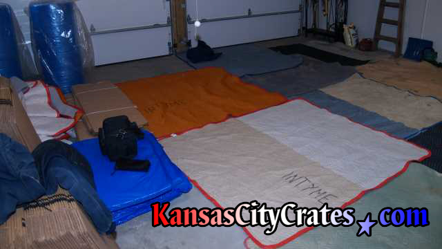 We lay out blankets on concrete garage floors too!
