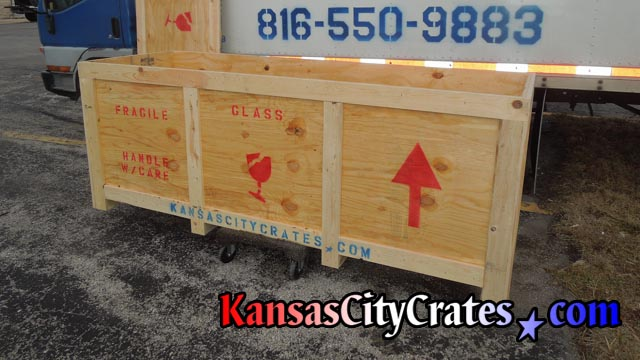 Large shipping vault on cart loading for delivery to business in Kansas City MO.