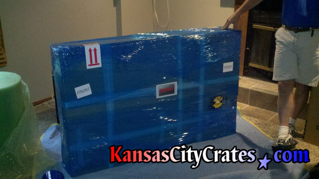 LG LED TV packaged for loading into crate at home in Kansas City MO  64146