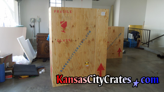 Vault like export crate of furniture marked for customs.