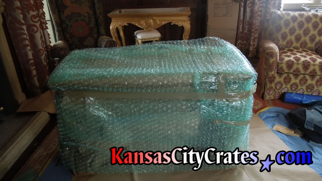 Bubble wrapped gold table ready for wood crate.