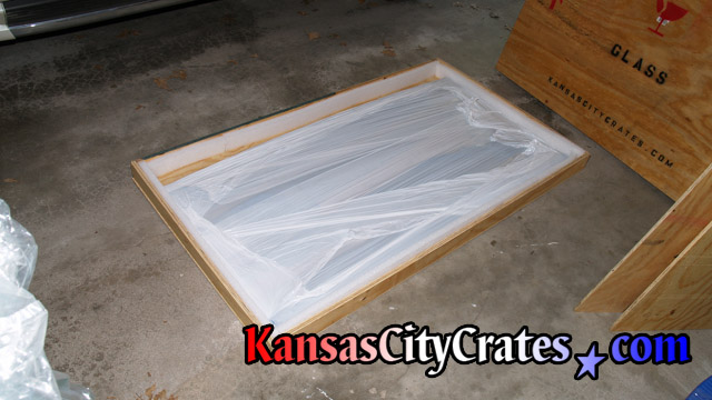 Glass top packed in wooden crate for international shipping.