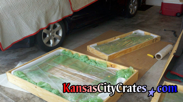 Wood crates for shipping odd shaped glass.