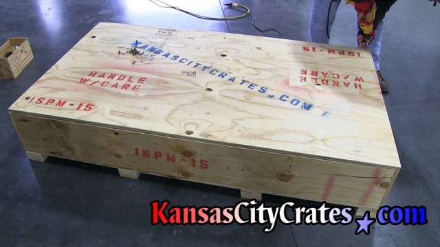 Injection mold machinery crate marked and ready for export to Canada.