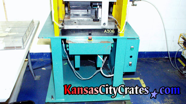 Measuring press for manufacturing computer parts to crate for shipment to Japan.