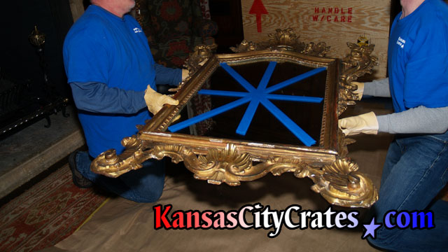 Antique mirror is handled with soft lambskin leather gloves to protect it's gold finish