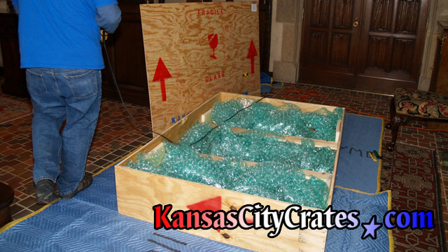 Mirror crate is carefully packed with bubble wrap to fill all voids and prevent mirror moving inside crate during transport.