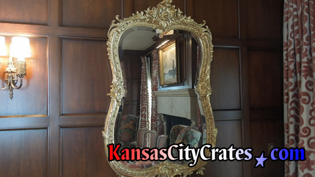 Mirror on wall in mansion before removal to pack in solid wall wooden crate for storage during rennovations at mansion in Mission Hills KS