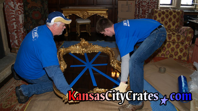 Mirrors are handled with lambskin gloves during the packing and crating process.