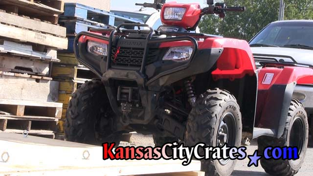 Honda four wheeler before loading onto crate pallet