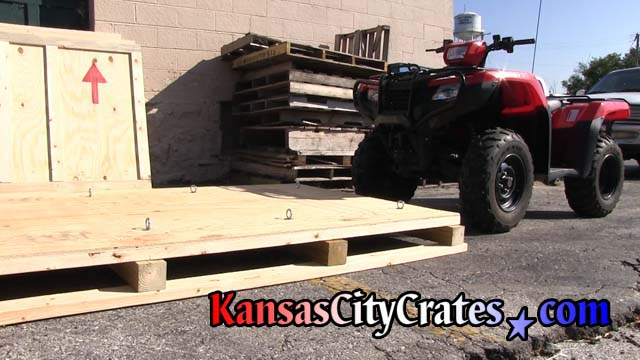 Crate pallet bottom in place for Honda ATV to load