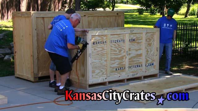 Attaching last end panel of crate for motorcycle shipping