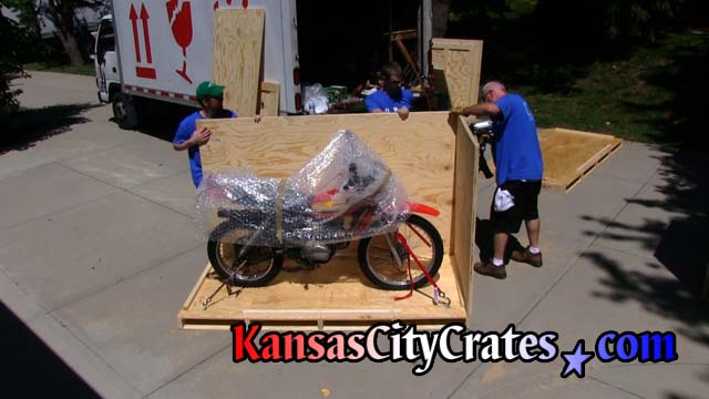 Crater fastens side wall of crate to pallet before shipping 1979 Honda XL 125S  to Canada