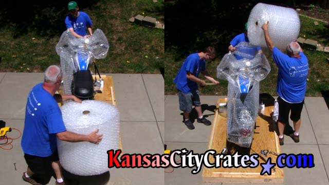 Crate builders bubble wrap motorcycle model that was made famous in the Steve McQueen movie The Great Escape