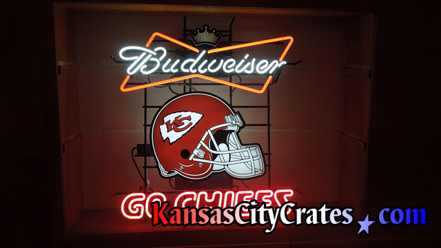 Budweiser neon sign lighted on wall before packing and crating.