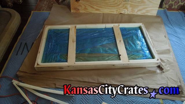 Glass top packaged in foam lined wooden crate at home in Greenwood MO  64034