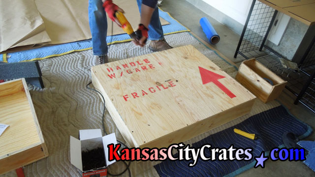 Crater closing wood crate with screws for storage of antique mirror at home in Olathe KS  66061
