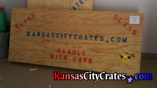 Two crates containing marble and glass marked for international shipment at home in Smithville MO  64164