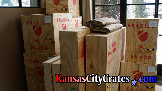 Eleven wood crates containing fragile household items for shipment at home in Edwardsville KS  66113