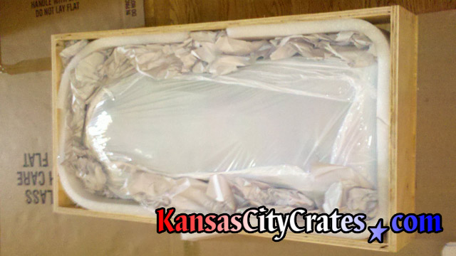 Wood crate with plaster cast of womans body carefully packed at home in Independence MO  64056