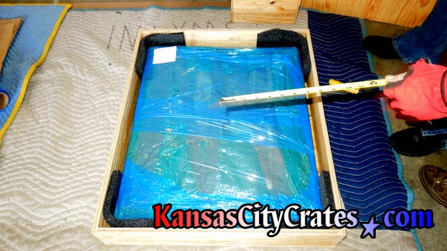 All wood sheathed crate with oil painting wrapped for storage at home in SPring Hill KS  66083