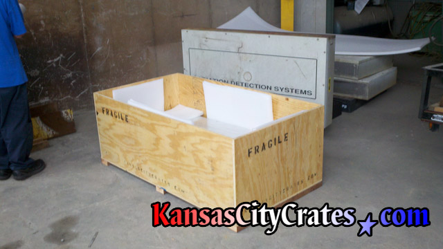 2 way forklift access on solid wall crate for shipping scientific testing equipment.