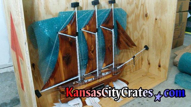 Vault like all wood crate with fragile handmade sailing ship at home in Excelsior Springs MO  64024