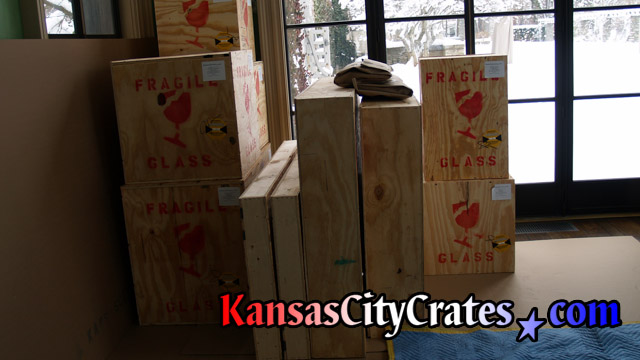 11 wood sheathed crates containing artwork and statues at home in Grain Valley MO  64029