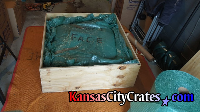 Before fastening lid example photo of wood crate filled with bubble wrap at home in Roeland Park KS  66205