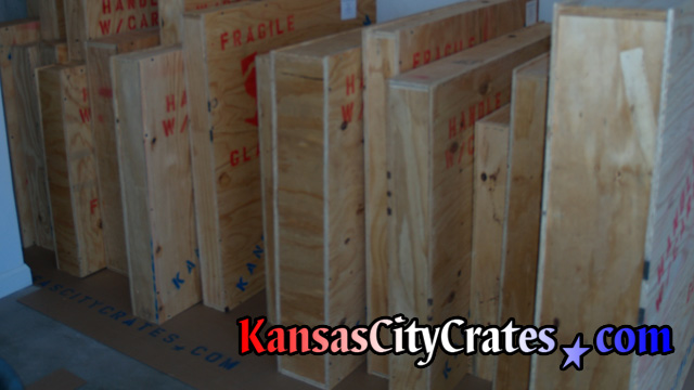 19 wood crates on wall in garage at home in Peculiar MO  64078