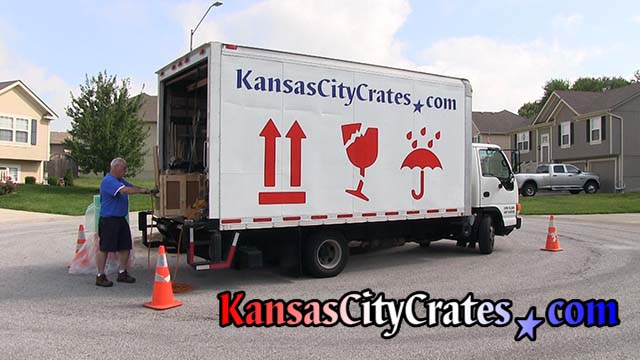 Crate builder assembles crate at business in St Joseph MO  64501