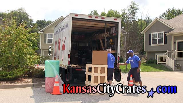 2 crate builders assemble wood domestic slat crate at home in Kansas City MO  64167