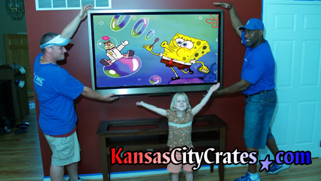 Brandy Murphy's television on wall with her daughter watching Spongebob Square pants