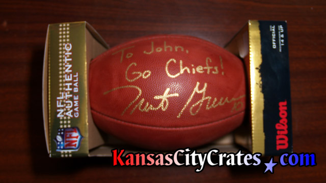 Trent Green autographed football personalized and given to John McLaughlin for his work